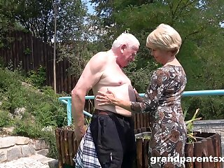 Old dude sticks his dick in a younger girl's pussy in outdoors