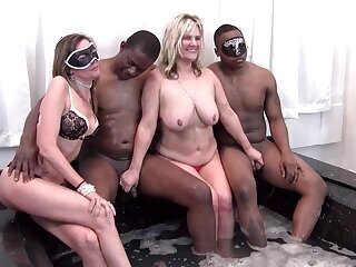 Blonde MILFs giving blowjob regarding Jacuzzi foursome